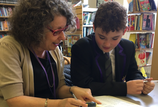 Phoenix Group staff become 'reading partners' to local school