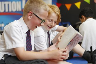 Happy boys reading
