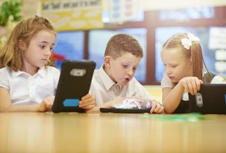 Boy and girl with technology tablet reading
