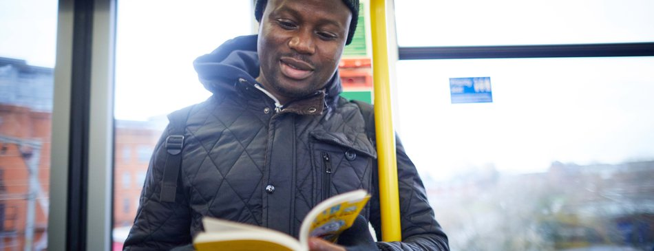 Commuter Sam Owiredu with his free book on the tram