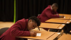 Secondary pupil taking exam