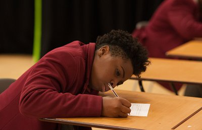 Secondary school boy writing - small
