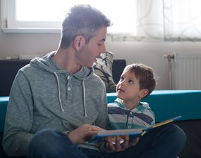 Dad and son sharing a book.jpg
