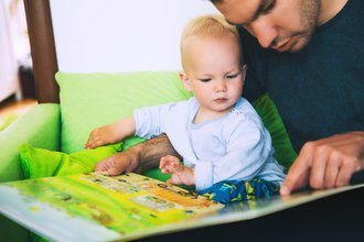 Dad reading with son.jpg