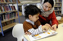 EWT 4 yo girl and mum in library reading.jpg
