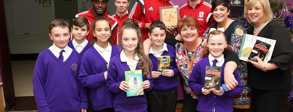 MFC footballers give out books