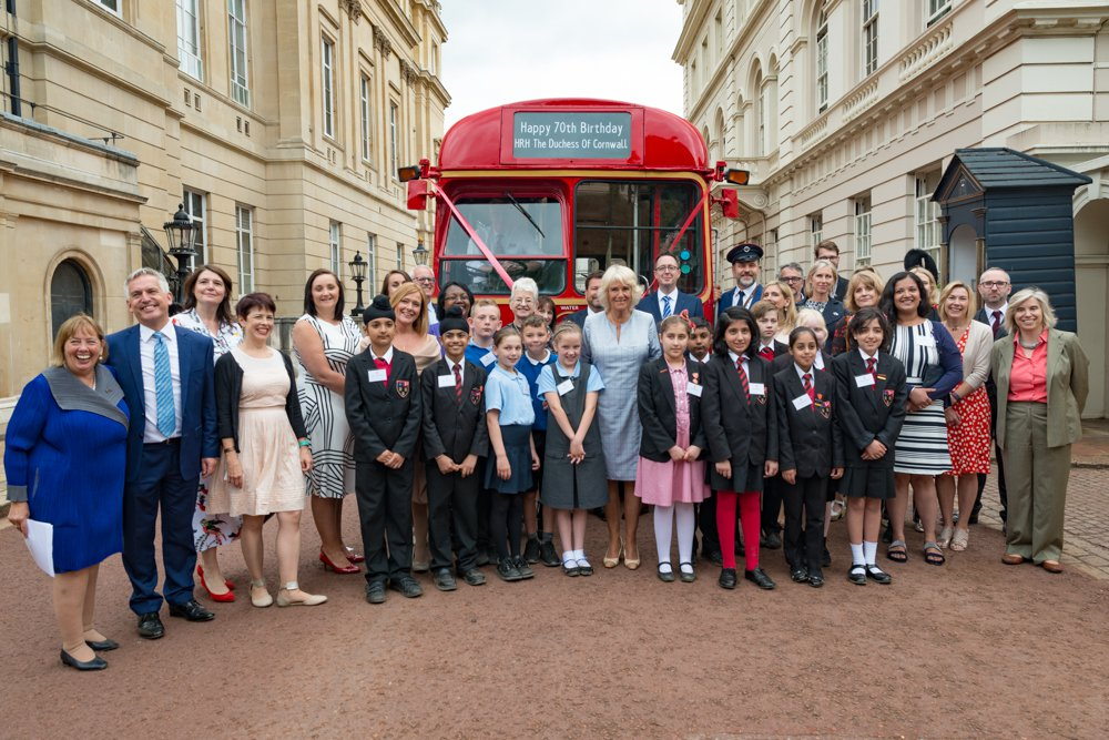 HRH authors, pupils and charity partners at duchess's bookselves