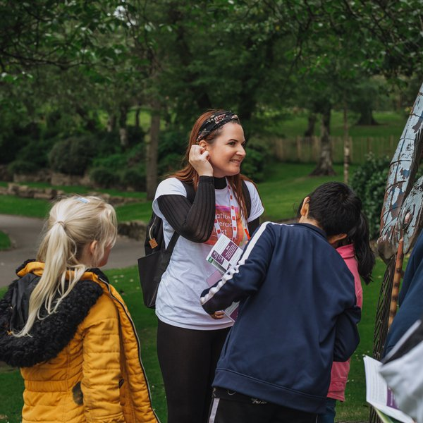 National Literacy Trust staff leading families on a Story Quest in Burslem Park at launch event