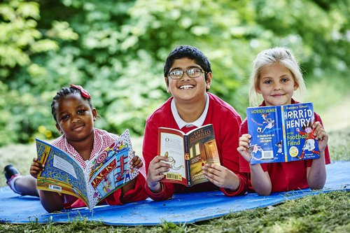 Kids with books in Leicester.jpg