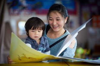 Everyone Ready for School parent with child and book