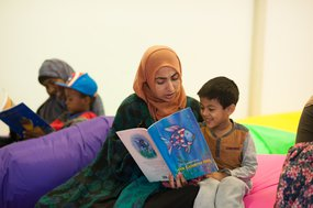 Mother reading to early years child.jpg