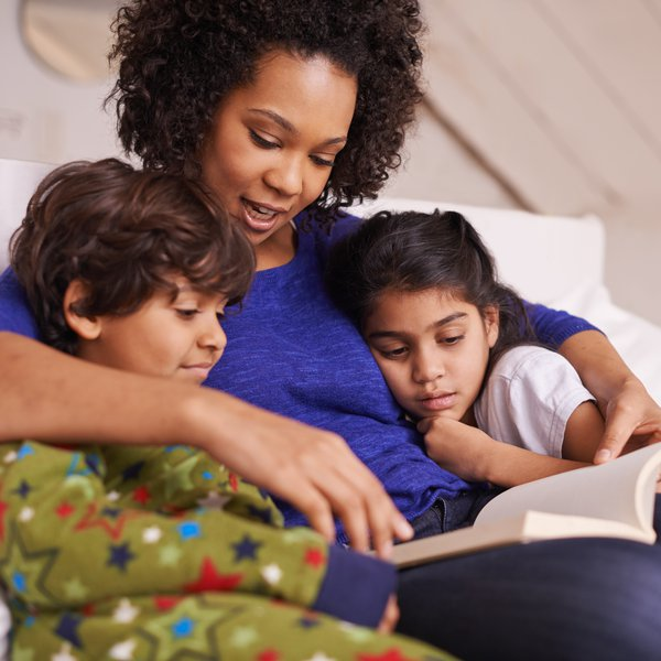 Mum reading with son and daughter.jpg