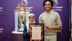 Premier League Writing Stars KS2 national winner Maariya 9 with poet Joseph Coelho.jpg