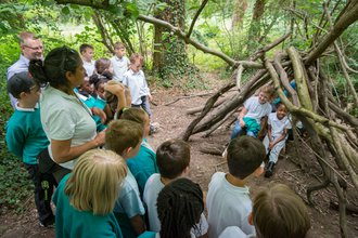 Pupils build dens at the Ernest Cook Trust's Redwood Outdoor Centre with volunteers from the P&M Group.jpg