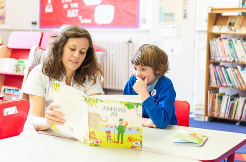 Teacher reading with child.jpg