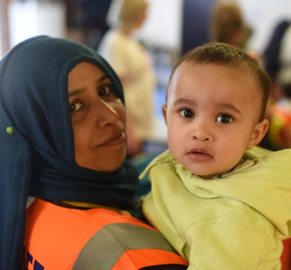 Woman in high vis carrying young boy.jpg