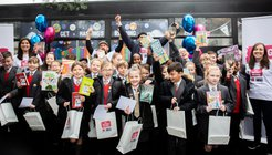 Children from Ark Little Ridge Primary Academy receive free books to take home