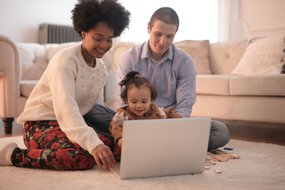 parents and child at laptop.jpg