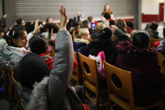 Young Readers Programme child raising hand