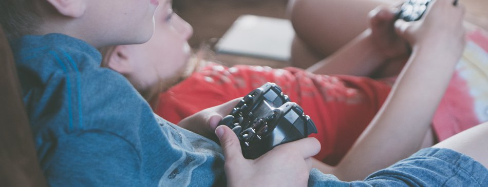 Children playing video games together