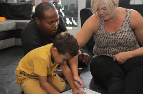Family with small child doing literacy activity
